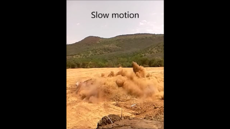 Slow-motion rock blasting